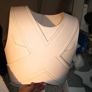 The glued X on chest