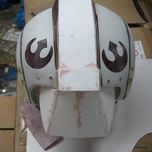 originally the helmet split in two, so I covered that seam with sintra and used bondo to fill the gaps.