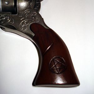 The Colt, closer up on the grip carvings.