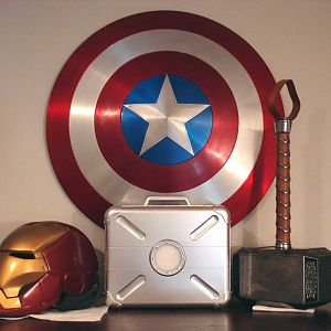 My in progress Iron Man helmet, aluminum Captain America shield, eFX Thor's Hammer and the special edition Avengers case with Tesseract.