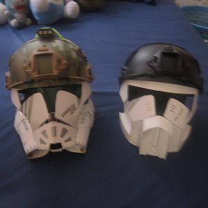 The Alien Mk.1 helmet on the left ...ignore the right helmet, the black helmet one, coz that faceplate had already been scrapped, as I planned on work