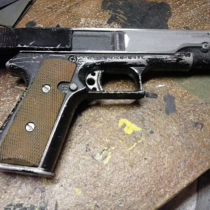 I wasn't happy with the black finish, so I began polishing the BB gun down to it's cast metal finish.
