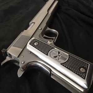 An AMT Hardballer Longslide.  This firearm had issues with its springs.  I also had custom Punisher grips made and polished the entire firearm to a mi